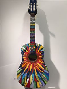 Another stained glass mosaic on an old guitar.
