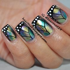 Metallic holographic butterfly wings free hand nail art design using China Glaze Bohemian collection polish