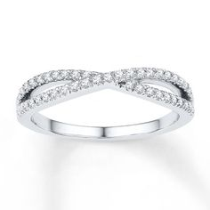 Lines of captivating round diamonds criss-cross over one another in this lovely ring for her. The ring is styled in sterling silver and has a total diamond weight of 1/4 carat. Diamond Total Carat Weight may range from .23 - .28 carats.