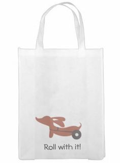 IVDD awareness tote bag featuring The Smoothe Store's Flying Ears dachshund in wheels. Doxie with IVDD just Roll with it!