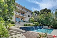 Cha ching: Natasha Bedingfield is selling this fully renovated 1950's home in Los Feliz for the asking price of $4.75 million dollars