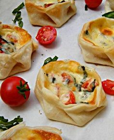 basil, tomato, and mozzarella. Use wonton wrappers...put a little sausage in these, yummy!