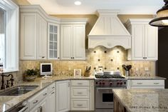 Glass Tile, Range Hood & Granite Countertop Arrangement Idea in Traditional Kitchen -  Tan Wall, Frosted Glass, …