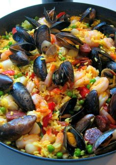 Paella - traditional Spanish seacoast stew. With Saffron rice, mussels, shrimp, veggies, and sometimes sausage.