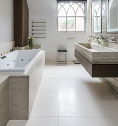 An almost white limestone with a small amount of pale shell fossiling. A perfect neutral stone for use in elegant interiors. Ceramic Tile Floor Bathroom, Best Bathroom Tiles, Bathroom Flooring, Bathroom Ideas, Flagstone Flooring, Limestone Flooring, Commercial Interiors, Amazing Bathrooms, Neutral
