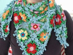 Gorgeous crochet shawl.  This is the shawl I will make and wear when I'm an old lady, still crocheting in a rocking chair on a porch somewhere.  Quite sure that rocker will be bright fuchsia or teal and there I will be, wearing my beautiful shawl, making something lovely.