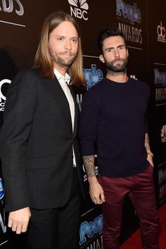 James Valentine and Adam Levine Maroon 5 band members James Valentine and Adam Levine smile for the cameras before taking the stage to perform one of their hits.