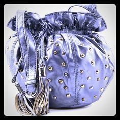 """NEW Steve Madden small drawstring Crossbody bag Steve Madden Karma Women Blue Messenger   BRAND: Steve Madden  Condition:  New with tags   Brand/Style:  Steve Madden Karma   Color:  Blue   Material:  Faux Leather   Dimensions:  8"""" W x 7.5"""" H x 5.5"""" D   Shoulder Strap Drop:  in. Approx 22"""" ( Crossbody) give or take an """".   Sku:  1840378   Carry your belongings with ease in the Karma bag from Steve Madden. Made of quality Faux Leather materials, this will keep your essentials on-hand with…"""