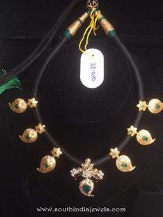 Gold Black thread mango necklace adorned with emeralds and white stones. Gold Earrings Designs, Gold Jewellery Design, Bead Jewellery, Pendant Jewelry, Beaded Jewelry, Silver Jewellery, Necklace Designs, Jewlery, Gold Designs