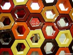 SPanish Pavilion-FOA created this seemingly irregular hexagonal tiling by simply shifting some of the internal vertices of groups of 8 tiles. By coloring the tiles in various colors, this further breaks up the underlaying regular pattern.