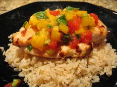 Grilled lime chicken with mango salsa: chicken marinade with lime and garlic + mango, tomatoes, green/red peppers, cilantro, green onions