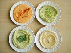 four flavors of homemade hummus
