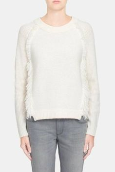 Refresh your classic style with this White  Warren sweater. Ivory cashmere makes up this super soft pullover with a touch of modern flare with the bordering fringe. Wear this piece with ivory skinny jeans and tan suede booties for a tonal fall look or with a pair of distressed grey jeans to take this piece to the weekend farmers market.  Cashmere Fringe Sweater by White  Warren. Clothing - Sweaters - Cashmere Clothing - Sweaters - Crew & Scoop Neck New York City