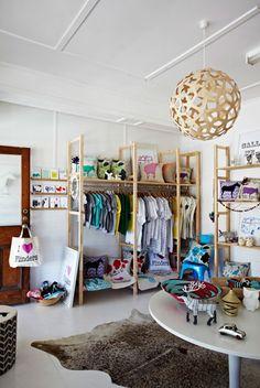 Great use of IKEA's IVAR shelf system as an open closet! {Image via Clair Wayman}