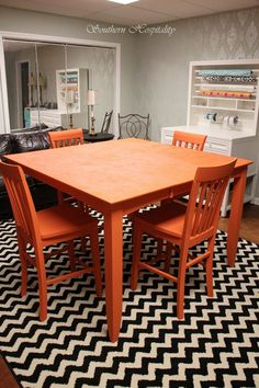 "Rhoda from Southern Hospitality Blog updated this basic Craigslist table with a punch of orange paint in our ""DIY on a Dime: Easy Design Projects for Every Space"" Blogger Challenge."