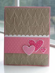 Embossed back + stripe in pattern or ribbon + hearts.