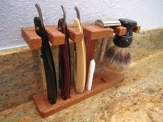 Straight razors are too beautiful to be kept in a case. They need to be on the counter standing proud next to the toothpaste. This straight razor stand was a single-evening project using scrap waln… Straight Razor Shaving Kit, Barber Straight Razor, Shaving Razor, Wet Shaving, Custom Straight Razors, Shaving Tips, Shaving & Grooming, Men's Grooming, Shaving Stand
