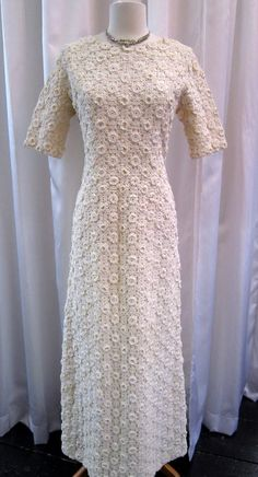 1960s Sybil Connolly cream crochet wedding gown I like the actual crochet designs just not the dress.