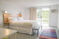 A newly renovated classic motel with clean, contemporary style, vintage summer cabins, outdoor pool, ocean views and a great location in midcoast Maine. Summer Cabins, Outdoor Pool, Motel, Contemporary Style, Maine, Bedroom, Architecture, Inspiration, Furniture
