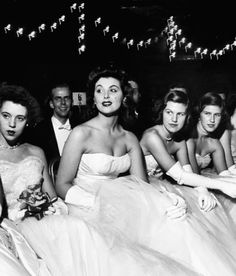 Debutante-actress Tina Louise attending a party, 1952. Photo by Nina Leen