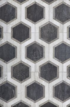 From Walker Zanger, Sterling Row Hexagon, a wood-finish ceramic tile.