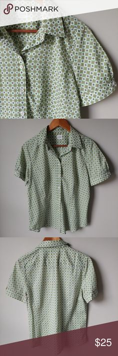 """J. Crew short sleeve button-up shirt Cute and light top great for spring and summer or layered for cooler days. Cotton is soft and light but not see-through. The sleeves have a pretty pleated detail at the arm. Also has two buttons on sleeve to adjust to comfort. The size tag is missing so check measurments to be sure. Seems like a 10-12 size. Measurments taken flat are: Pit to pit 20"""" Shoulder to hem 25"""" Widest arm width 7""""  🌻Check out my daughter's closet too! @mrwidmer J. Crew Tops…"""