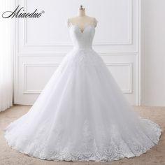 2018 Ball Gown White Wedding Dresses Lace Appliques Bridal Gowns Vestido De  Novias Princess Long robe e8189e577312