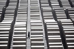 A visitor walks through the snow covered Holocaust memorial in Berlin, Germany