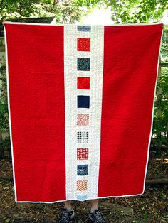 America, the Quilt - The back is kona red and the binding is kona white. The strip down the middle is mostly connecting threads white with some kona mixed in