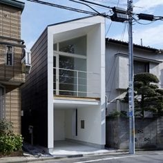 The Japanese architecture firm, Another Apartment, designed this small house on a narrow lot in suburban Tokyo. The house features a glazed façade that pro Japanese Architecture, Interior Architecture, Minimalist Architecture, Interior Design, Koshino House, Casa Park, Mini Loft, Compact House, Narrow House
