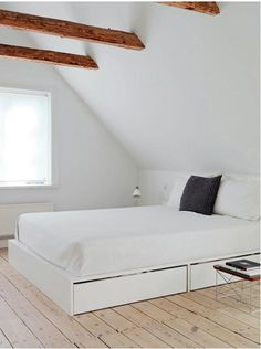 bedrooms-white-beds-bedspreads-built-in-furniture-exposed-beams-pillows-side-tables