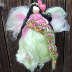 Evas Garden Fairy-  CustomNeedle felted wool fairy angel Waldorf inspired creation by Rebecca Varon aka Nushkie. $48.00, via Etsy.