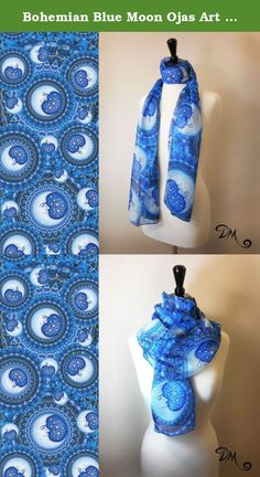 Bohemian Blue Moon Ojas Art Scarf by Dan Morris. Ojas Blue Moon Art Scarf by Dan Morris features hand drawn moon faces. Show off your love for the celestial theme with this beautiful accent piece. 100% Polyester Chiffon 70 inches long by 20 inches wide Original artwork of Dan Morris only available through Dan Morris Design, Inc. ©Dan Morris, copyright strictly enforced.
