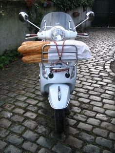 Vespa's are the norm for transportation around the historic towns of Italy! Pair this ride along with fresh bread and you have a true Italian moment! #Lifestyle # Italy