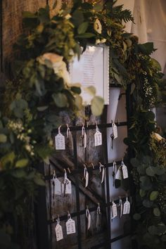 We used an old metal gate for E & B's seating chart. Mounted against an exterior barn wall and draped with garland and flowers, it was a focal point as guests entered the barn.