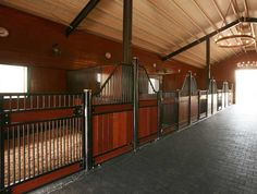 Chandeliers add an extra touch of class in this TX barn - as do the Savannah horse stalls by Innovative Equine Systems.