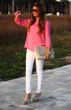 Pink blouse and white pants.