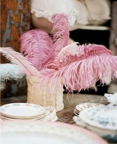 pretty pink feathers in a tall glass vase
