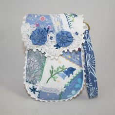 Embroidered Pouch / purse/ wristlet - Blue crazy patchwork and lace with vintage linens and lace panels hand stitched by Lynwoodcrafts on Etsy https://www.etsy.com/listing/181092571/embroidered-pouch-purse-wristlet-blue