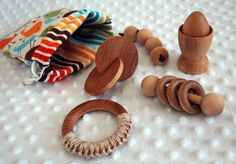 Montessori wooden toys-Love this one... all great for teething and keeping their interest! YAY montessori!