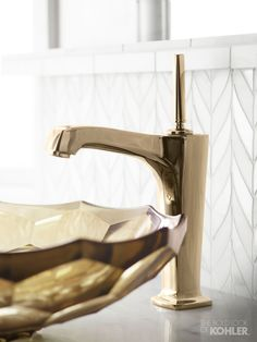 The simple lines and slender lever on this Margaux faucet allow the mosaic backdrop to shine.