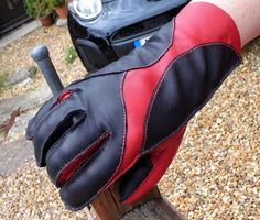 Hand stitched black and red lamb nappa glove.