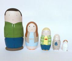 Family nesting dolls by photo. Matryoshka dolls.