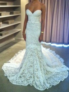 This lace and style is beautiful! I WANT this dress.