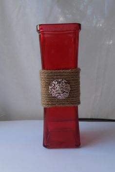 A personal favorite from my Etsy shop https://www.etsy.com/listing/450249948/red-glass-vase-wrapped-with-rope-and