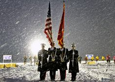 Rain or shine ... or snow, Marines will always pay tribute to the colors.     (U.S. Marine Corps photo by Sgt. Kevin  Maynard)
