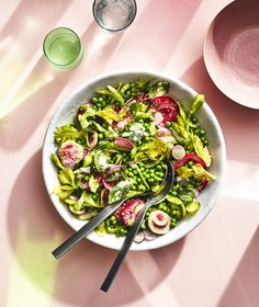 English Pea-Radish Salad With Celery and Miso | This is one of the most gorgeous, satisfying spring salads we can possibly imagine. Suitable for any special occasion lunch, it's made with colorful, fresh radishes, peas, celery, and mint leaves. The peas are blanched and shocked in ice water to intensify their color, but the rest of the vegetables are served raw and crunchy. Although it's a light dish, it gets dressed in a satisfying dressing that's full of umami, thanks to white miso, rice…