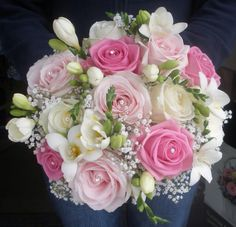 Stunning bouquet of cream and pink roses, baby's breath and freesia's