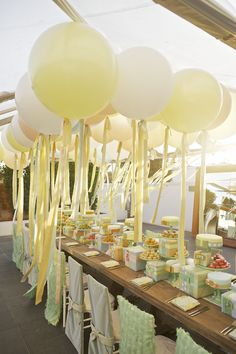 Pastel yellow and white balloons for dessert table.