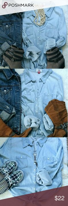 Must have Chambray Shirt A wardrobe essential! Chambray shirt with knot tie bottom. You can dress it up or make it casual! Add chunky pearls, booties, and a jean jacket for more of a street style look! Or go country with cowboy boots! Also cute with Sperry shoes and shorts! Size large Tops Button Down Shirts